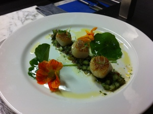 Seared scallops with tomato and cucumber salsa, and nasturtium salad