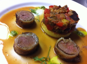 Lamb fillet with coriander pesto, polenta galette and ratatouille